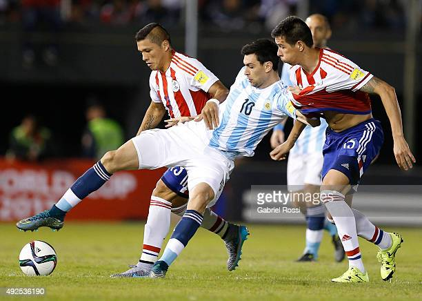 Javier Pastore of Argentina fights for the ball with Victor Caceres of Paraguay during a match between Paraguay and Argentina as part of FIFA 2018...