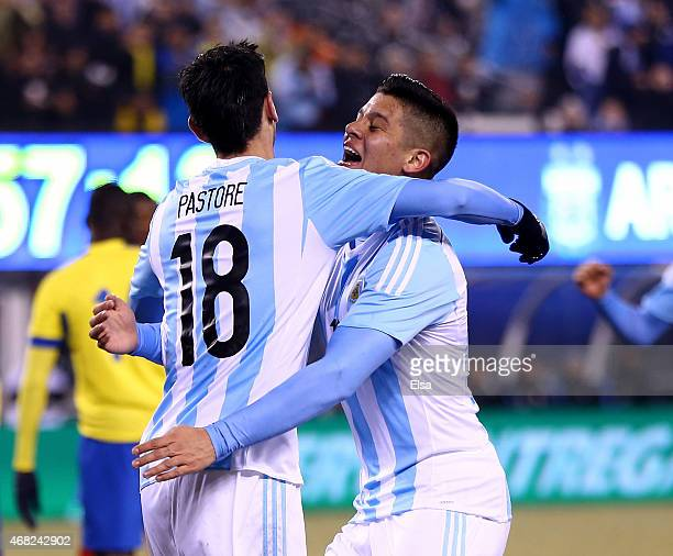 Javier Pastore of Argentina is congratulated by teammate Marcos Rojo after Pastore scored a goal in the second half against Equador during a friendly...