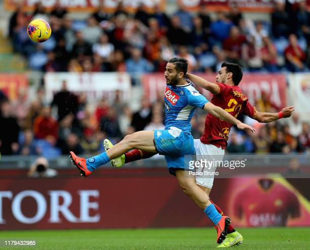 Javier Pastore of AS Roma competes for the ball with Kostas Manolas of SSC Napoli during the Serie A match between AS Roma and SSC Napoli at Stadio...