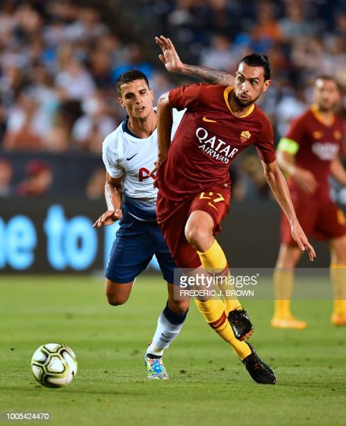 Javier Pastore of AS Roma vies for the ball with Erik Lamela of Tottenham Hotspur during their International Champions Cup match in San Diego...