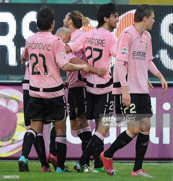 Javier Pastore of Palermo celebrates with teammates after scoring his third goal during the Serie A match between Palermo and Catania at Stadio Renzo...