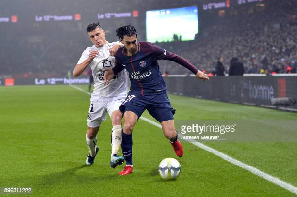 Javier Pastore of Paris SaintGermain and Frederic Guilbert of SM Caen fight for the ball during the Ligue 1 match between Paris Saint Germain and SM...