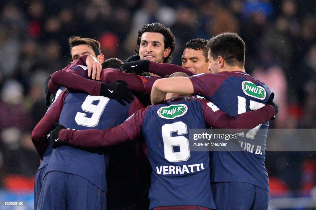 Javier Pastore of Paris Saint-Germain and teammates congratulate Edinson Cavani for his goal during the French Cup match between Paris Saint-Germain and Olympique de Marseille at Parc des Princes on February 28, 2018 in Paris, France.