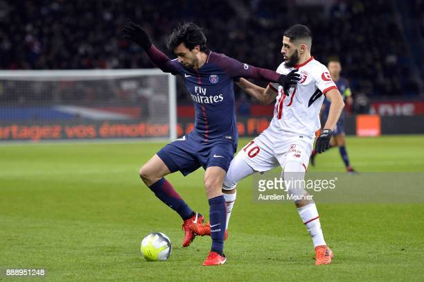 Javier Pastore of Paris SaintGermain and Yassine Benzia of Lille OSC fight the ball during the Ligue 1 match between Paris Saint Germain and Lille...