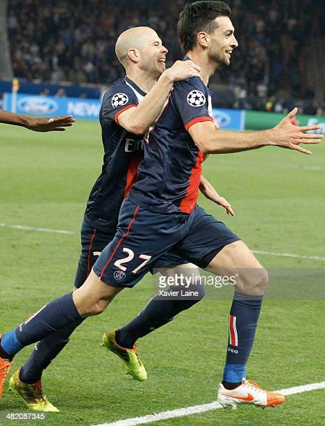 Javier Pastore of Paris SaintGermain celebrate his goal and victory with teammatte during the UEFA Champions League Quatrer Finale between Paris...