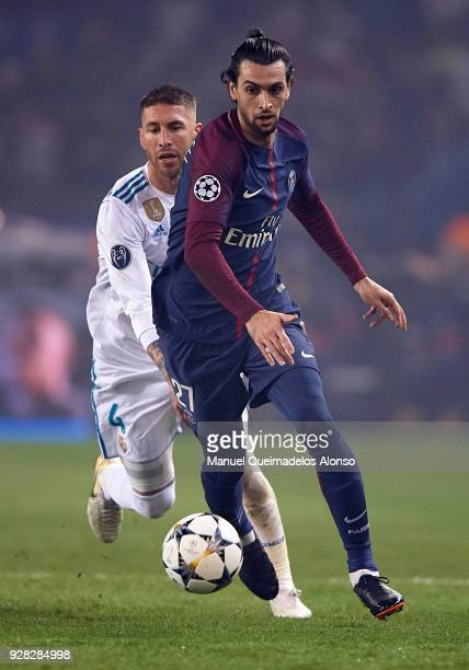 Javier Pastore of Paris SaintGermain competes for the ball with Sergio Ramos of Real Madrid during the UEFA Champions League Round of 16 Second Leg...