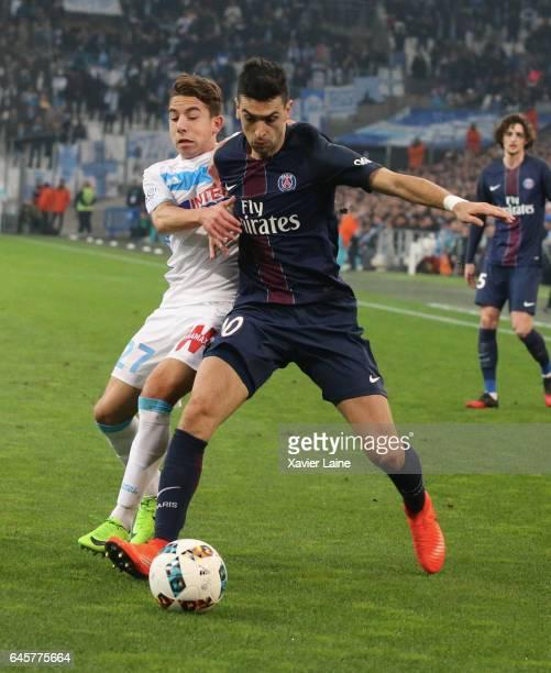 Javier Pastore of Paris SaintGermain in action with Maxime Lopez of Marseille during the French Ligue 1 match Olympique de Marseille and Paris Saint...