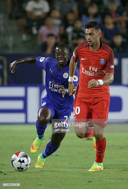 Javier Pastore of Paris SaintGermain is pursued by Nampalys Mendy of Leicester City during the 2016 International Champions Cup at StubHub Center on...