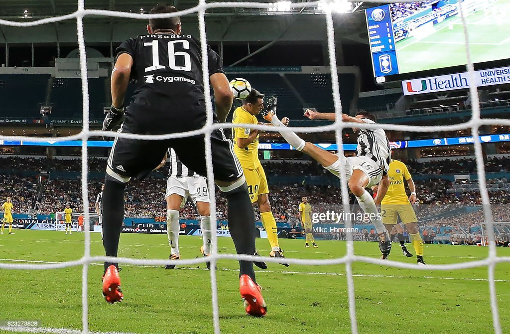 Javier Pastore #10 of Paris Saint-Germain scores a goal on Carlo Pinsoglio #16 of Juventus during the International Champions Cup 2017 match against the Juventus at Hard Rock Stadium on July 26, 2017 in Miami Gardens, Florida.