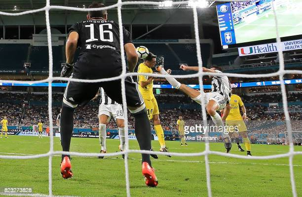 Javier Pastore of Paris SaintGermain scores a goal on Carlo Pinsoglio of Juventus during the International Champions Cup 2017 match against the...