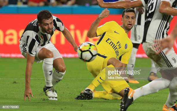 Javier Pastore of Paris SaintGermain shoots on Andrea Barzagli of Juventus during the International Champions Cup 2017 match at Hard Rock Stadium on...