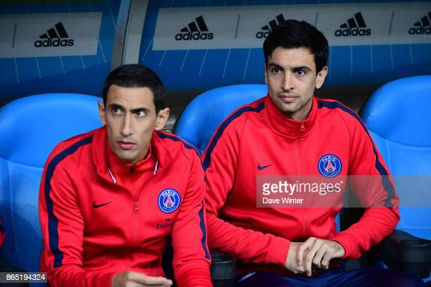 Javier Pastore of PSG and Angel Di Maria of PSG on the bench during the Ligue 1 match between Olympique Marseille and Paris Saint Germain at Stade...