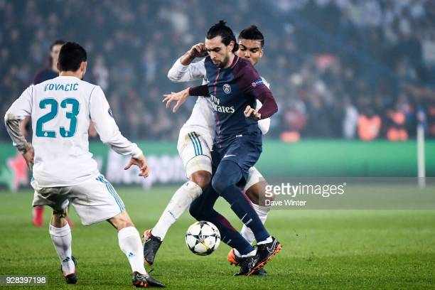 Javier Pastore of PSG and Casemiro of Real Madrid during the UEFA Champions League Round of 16 Second Leg match between Paris Saint Germain and Real...