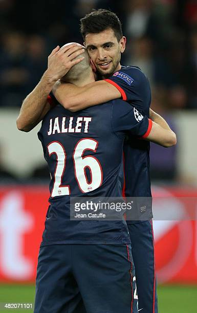 Javier Pastore of PSG and Christophe Jallet of PSG celebrate the victory at the end of the UEFA Champions League quarter final match between Paris...