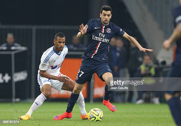 Javier Pastore of PSG and JacquesAlaixys Romao of OM in action during the French Ligue 1 match between Olympique de Marseille and Paris SaintGermain...