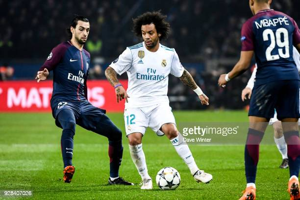 Javier Pastore of PSG and Marcelo of Real Madrid during the UEFA Champions League Round of 16 Second Leg match between Paris Saint Germain and Real...