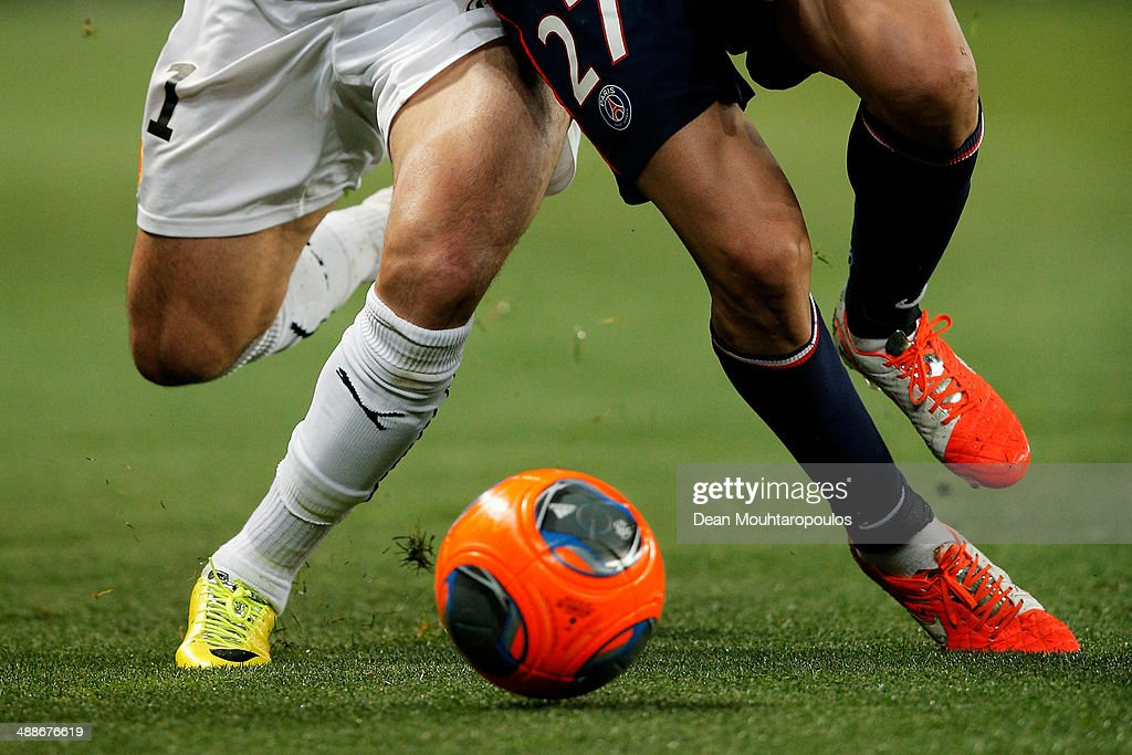 Javier Pastore of PSG and Nelson Miguel Castro Oliveira of Rennes battle for the ball during the Ligue 1 match between Paris Saint-Germain FC and Stade Rennais FC at Parc des Princes on May 7, 2014 in Paris, France.