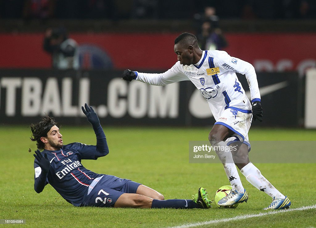Javier Pastore of PSG and Sambou Yatabare of SC Bastia in action during the French Ligue 1 match between Paris Saint Germain FC and Sporting Club de Bastia at the Parc des Princes stadium on February 8, 2013 in Paris, France.