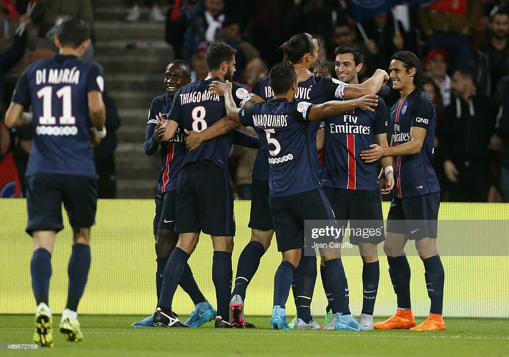 Javier Pastore of PSG celebrates his goal with teammates during the French Ligue 1 match between Paris Saint-Germain FC (PSG) and EA Guingamp at Parc des Princes stadium on September 22, 2015 in Paris, France.