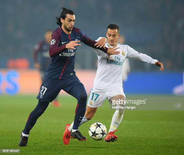 Javier Pastore of PSG holds off Lucas Vazquez of Real Madrid during the UEFA Champions League Round of 16 Second Leg match between Paris SaintGermain...