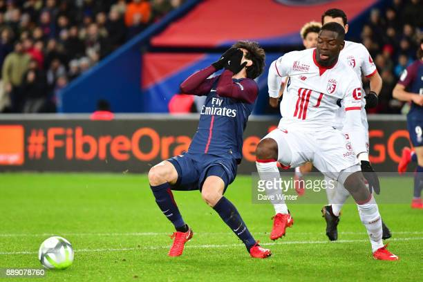 Javier Pastore of PSG is challenged by Adama Soumaoro of Lille and goes down claiming a penalty during the Ligue 1 match between Paris Saint Germain...