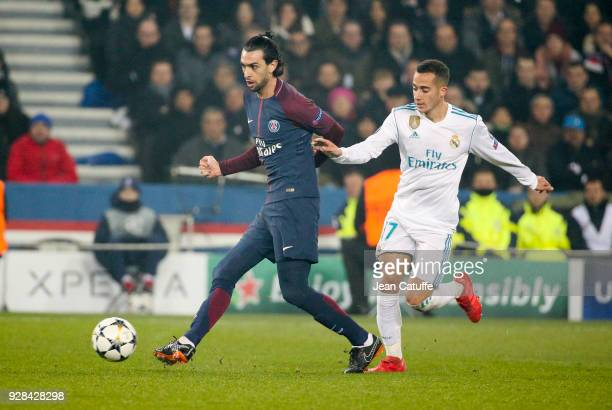 Javier Pastore of PSG Lucas Vazquez of Real Madrid during the UEFA Champions League Round of 16 Second Leg match between Paris SaintGermain and Real...
