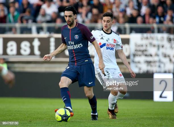 Javier Pastore of PSG Quentin Cornette of Amiens during the Ligue 1 match between Amiens SC and Paris Saint Germain at Stade de la Licorne on May 4...