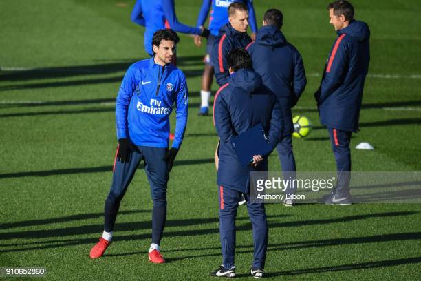 Javier Pastore of PSG talks with Unai Emery coach of PSG during training session of Paris Saint Germain PSG at Camp des Loges on January 26 2018 in...