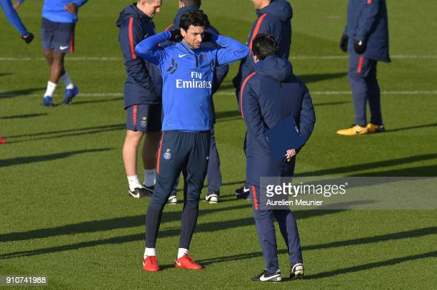Javier Pastore speaks with Head Coach Unai Emery as he arrives for a training session of Paris Saint Germain PSG at Camp des Loges on January 26 2018...