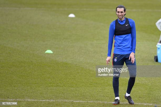 Javier Pastore warms up during a Paris SaintGermain training session ahead of the Champion's League match against Real Madrid at Centre Ooredoo on...