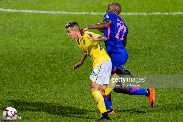 Javier Patino Lachica of Buriram fights for the ball with Kitchee Midfielder Mohamed Sissoko during the Preseason Friendly Match between Kitchee and...