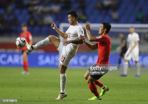 Javier Patino of the Philippines competes for the ball with Lee Yong of South Korea during the AFC Asian Cup Group C match between South Korea and...