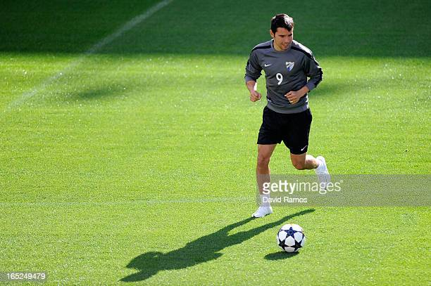Javier Pedro Saviola of Malaga CF controls the ball during a traning session ahead of their UEFA Champions League quarterfinal first leg match...