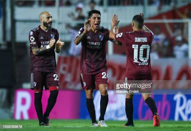 Javier Pinola , Enzo Perez and Juan Fernando Quintero celebrate after winning a match between Union and River Plate as part of Superliga 2019/20 at...