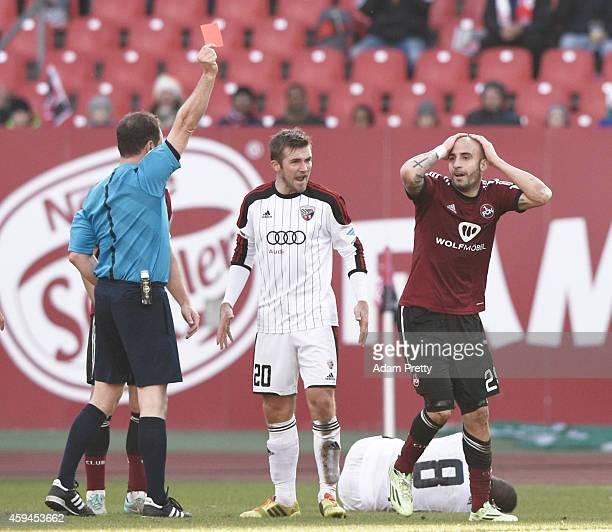 Javier Pinola of FC Nuernberg is shown a red card after fouling Bernardo De Oliveira of FC Ingolstadt during the 2 Bundesliga match between FC...