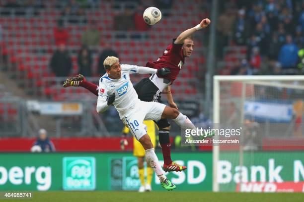 Javier Pinola of Nuernberg battles for the ball with Firmino of Hoffenheim during the Bundesliga match between 1 FC Nuernberg and TSG 1899 Hoffenheim...