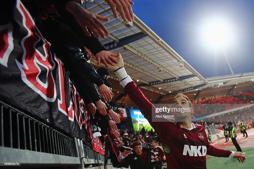 Javier Pinola of Nuernberg celebrates with the fans after the Bundesliga match between 1. FC Nuernberg and VfL Borussia Moenchengladbach at Easy Credit Stadium on February 3, 2013 in Nuremberg, Germany.