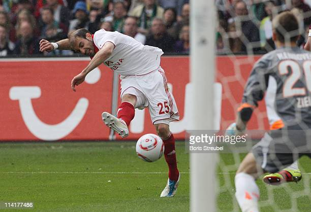 Javier Pinola of Nuernberg shoots the ball during the Bundesliga match between Hannover 96 and 1 FC Nuernberg at AWD Arena on May 14 2011 in Hanover...