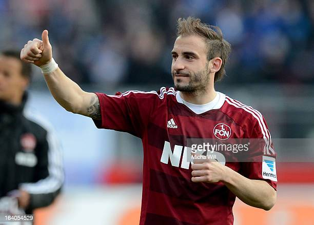 Javier Pinola of Nuernberg shows thumb up after the Bundesliga match between 1 FC Nuernberg and FC Schalke 04 at GrundigStadion on March 16 2013 in...