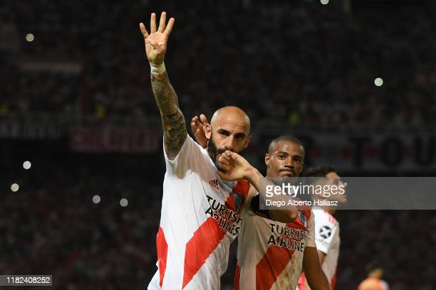 Javier Pinola of River Plate celebrates after scoring the first goal of his team with teammate Nicolas De la Cruz during a Semi Final match between...