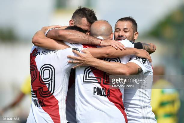 Javier Pinola of River Plate celebrates with Rodrigo Mora and teammates after scoring the second goal of his team during a match between Defensa y...