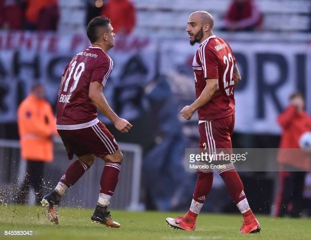 Javier Pinola of River Plate celebrates with teammate Rafael Santos Borre after scoring the first goal of his team during a match between River Plate...