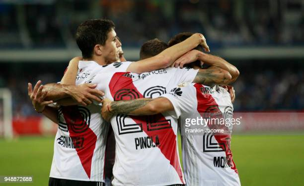 Javier Pinola of River Plate celebrates with teammates Gonzalo Montiel and Ignacio Fernández after scoring the first goal of his team during a match...