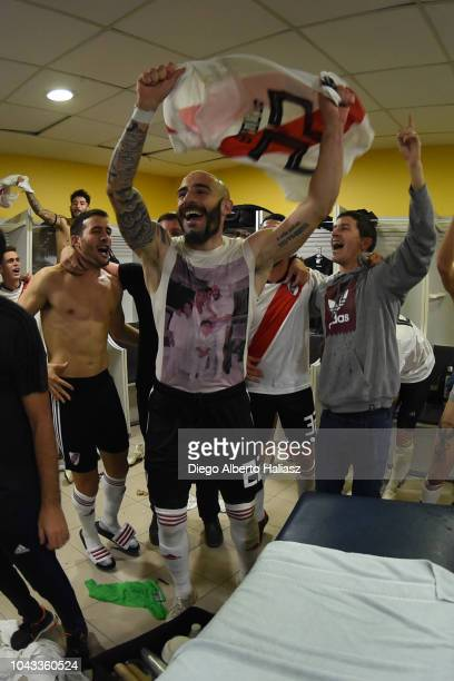 Javier Pinola of River Plate celebrates with teammates in the visitor's dressing room after a match between Boca Juniors and River Plate as part of...