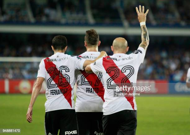 Javier Pinola of River Plate celebrates with teammates Lucas Pratto and Ignacio Fernandez after scoring the goal of his team during a match between...