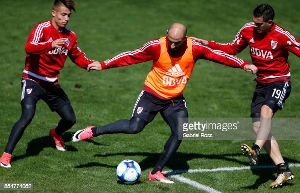 Javier Pinola of River Plate competes for the ball with Rafael Santos Borre of River Plate during a training session at River Plate's training camp...