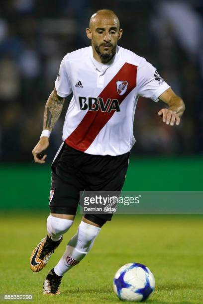 Javier Pinola of River Plate drives the ball during a match between Gimnasia y Esgrima La Plata and River Plate as part of the Superliga 2017/18 at...