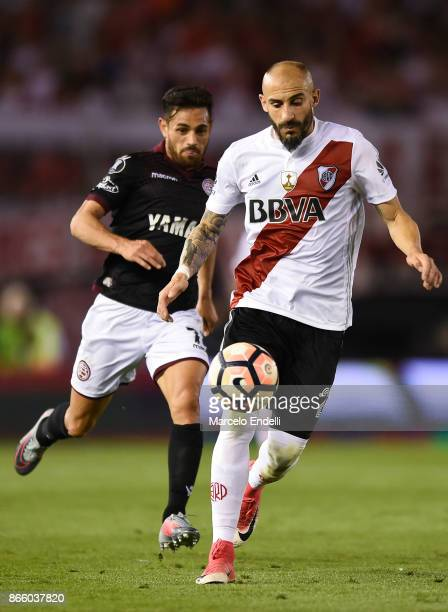 Javier Pinola of River Plate fights for the ball with Lautaro Acosta of Lanus during a first leg match between River Plate and Lanus as part of...