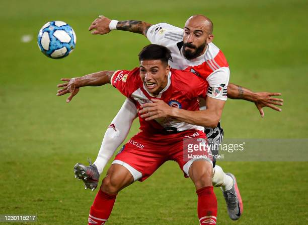 Javier Pinola of River Plate fights for the ball with Mateo Coronel of Argentinos Juniors during a match between River Plate and Argentinos Juniors...