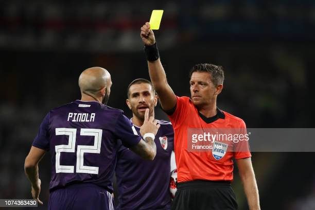 Javier Pinola of River Plate is shown a yellow card by referee Gianluca Rocchi during the FIFA Club World Cup UAE 2018 Semi Final Match between River...